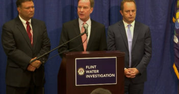 Workers charged in Flint water crisis suspended