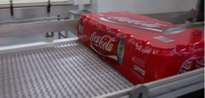Coke profit falls 28 percent, but beats expectations