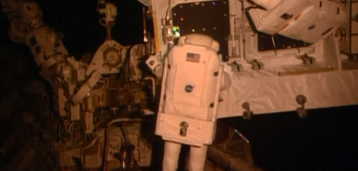 Spacewalking astronauts upgrading orbiting lab's power grid