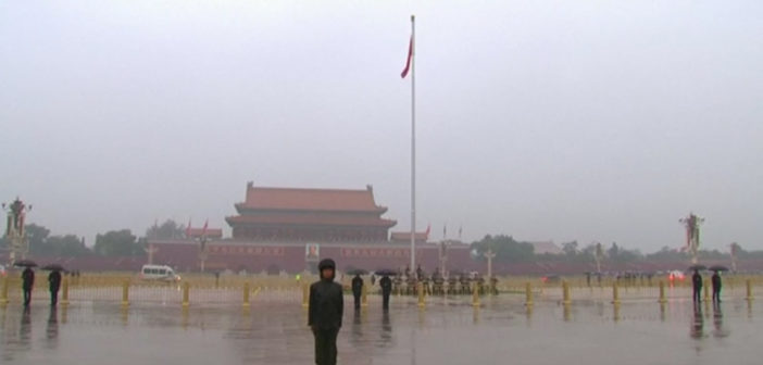 China's economic growth edges down in latest quarter